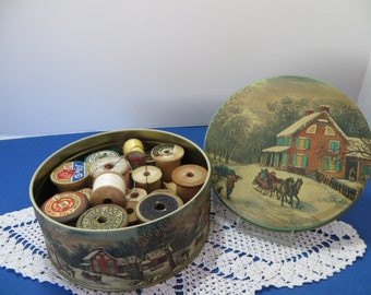 Vintage Tin Can with 20 Wooden Spools.