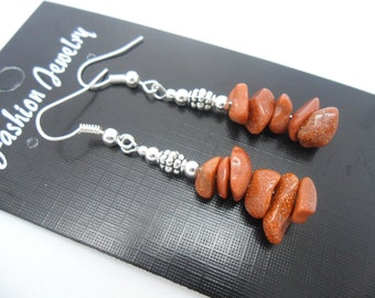 A pair of pretty brown goldstone  chips dangly earrings.