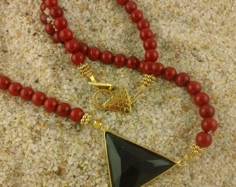 Vibrant Red Coral Bead Necklace with a dramatic triangle of black onyx.