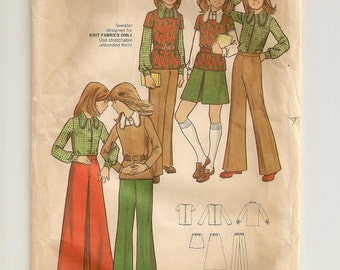 """A Long Sleeve Shirt, Close-Fitting Top, A-Line Inverted Pleat Skirt, and Flared Pants Pattern: Girls Size 8, Breast 27"""" • Butterick 6826"""