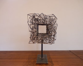 Original metal sculpture signed and dated.