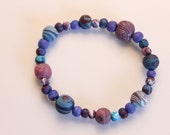 handcrafted bead bracelet in purples and blues