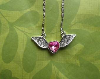 Angel wing pink  or blue heart crystal necklace
