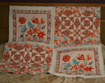 Quilted wall hanging or lap quilt. Machine pieced and quilted panel of birds & flowers and flirt fabrics
