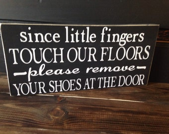 Since little fingers touch the floor, leave your shoes at the door, sign
