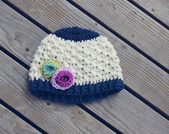 Textured crochet girls hat with colorful flower