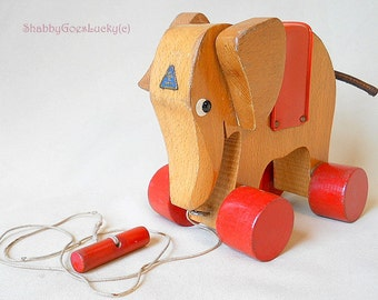 Vintage wooden pull along Elephant, 1960s marked HABA Elephant pull toy on eccentric wheels, small old wooden animal toy