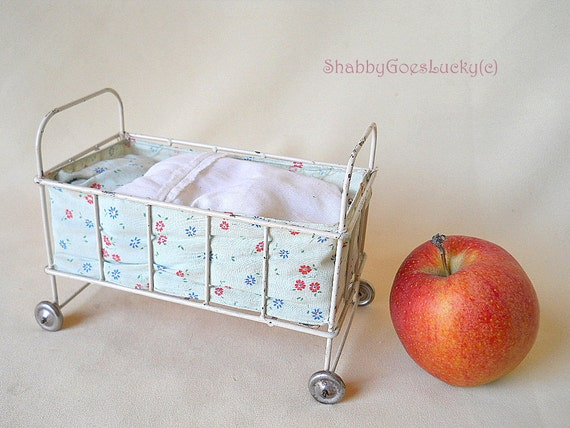 Small vintage 1950s metal doll bed on tin wheels with bedding for Baby bed with wheels