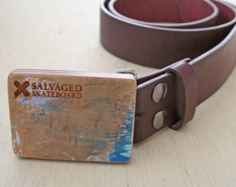 Belt buckle hand crafted from a recycled skateboard deck