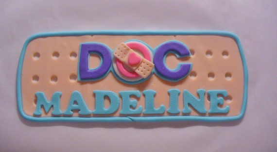 Edible Fondant Doc Mcstuffins Inspired Logo Band Aid Cake