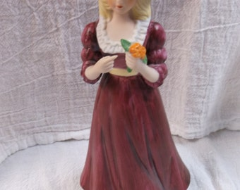 Vintage Woman in a burgundy dress figurine