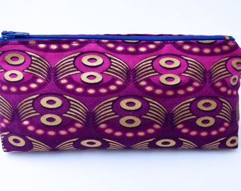 Handmade Make-up bag in beautiful geometric 'ring' motif fabric, in pink & purple with screen printed gold details