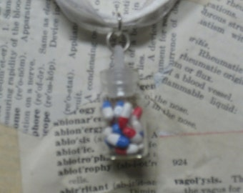 White bottle of pills necklace