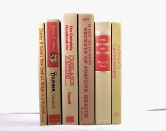 Red and beige decorative books, old books, beige books, book collection, books for home decor, books for wedding decoration, library decor