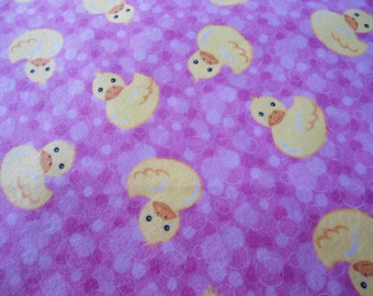 "34"" x 40"" Receiving Blanket with yellow ducks on bubbled pink back ground"