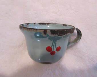 antique granitewear, child's toy cup,  pale turquoise with cherries