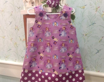 Sophia the First Dress, Purple with Dotted Band, (infant, baby, girl, toddler,child) with matching hair accessory.