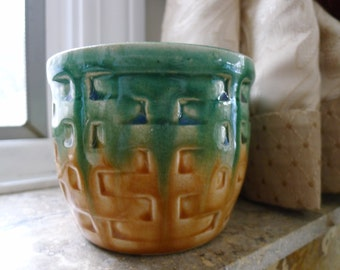 Embossed ceramic plant pot