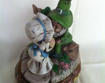 A Ceramic Dish With A Girl Kissing A Leprechaun