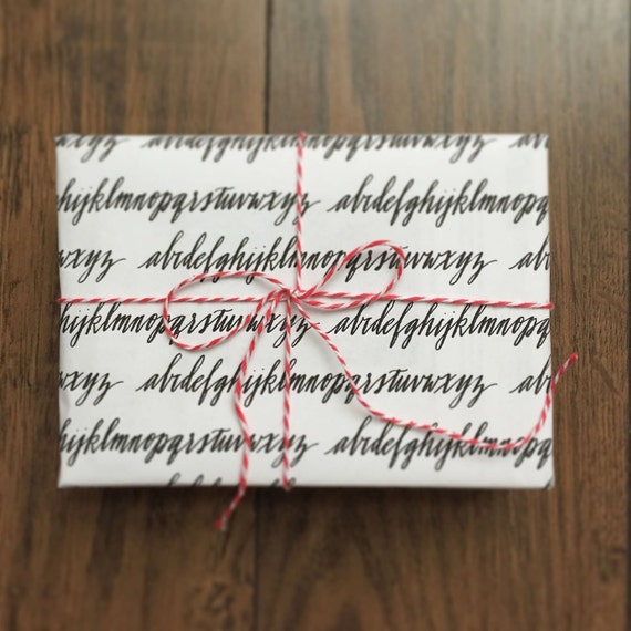Alphabet calligraphy gift wrapping paper by silbiaro on etsy