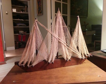 Vintage free standing wood and yarn sailing clipper ship