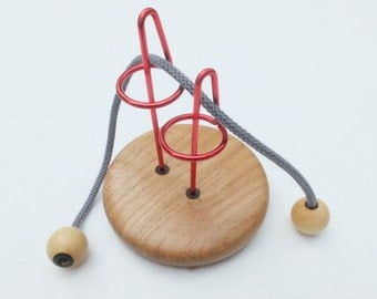"""metal and wood puzzle : """"fetiche"""""""
