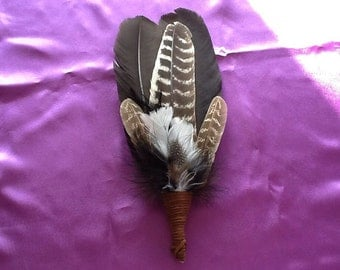 "Turkey feather smudge wand with quartz crystal. 12"" long"