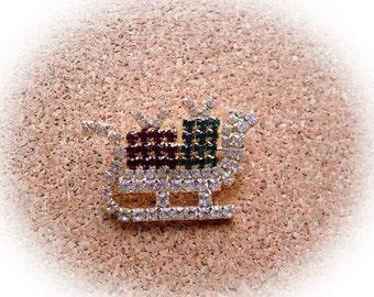 I15: Vintage rhinestone sleigh pin
