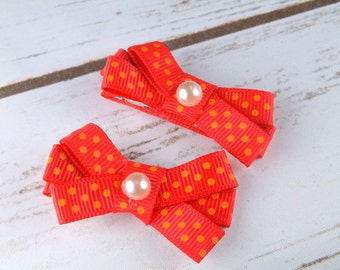 Girls hair clips - red and orange small bow