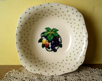 Vintage Hollinshead & Kirkham bowl decorated with fruits and stars