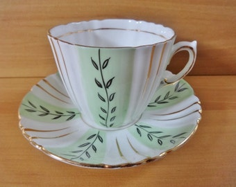 Lovely Vintage Phoenix Bone China Cup and Saucer Gold Green and Leaves
