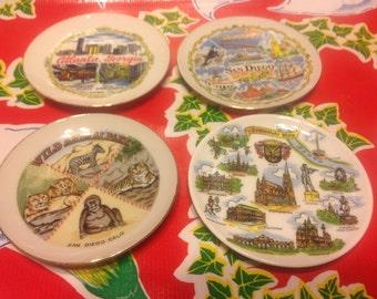 Vintage set of 4 miniature souvenir plates