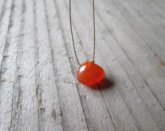 ORANGE CARNELIAN floating stone necklace on a fine silk cord dainty gemstone pendant July birthstone necklace