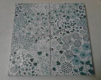 Set of 4 decoupage tile coasters. Turquoise flowers on white background. Flower coasters.