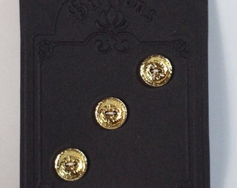 3 Buttons bijoux in plastic gold 16 mm 2 holes.