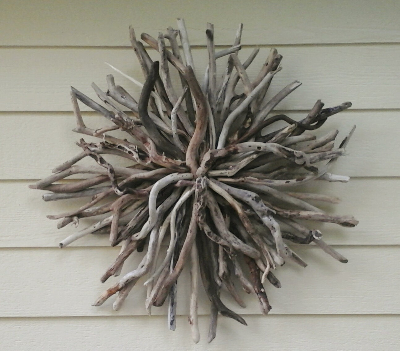 Driftwood sunburst outdoor rustic wall sculpture driftwood art for Driftwood wall