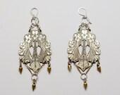 Iris statement chandelier earrings