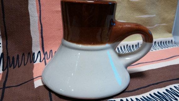 Wide bottom travel mug by aladdin