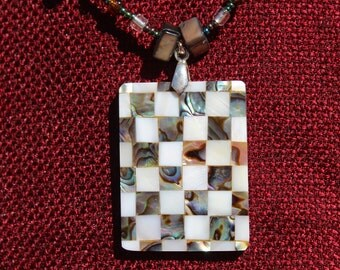 Checkerboard pendant on beaded necklace with matching earringd