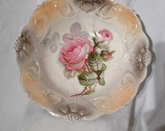 Beautiful vintage bowl made in Germany.  Beige scalloped edges with pink roses.