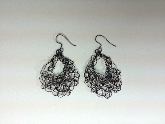Handmade black craft artistic wire crochet earrings.