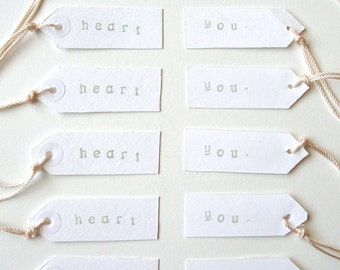 Parcel Tags , Gift tags, set of 12 hand cut white parcel tags with heart print
