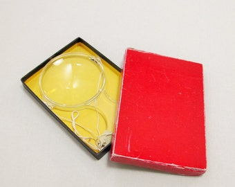 vintage handheld magnifying glass