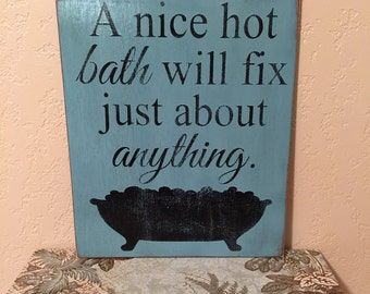 Rustic hand painted bathroom decor with a bathtub and bubbles.