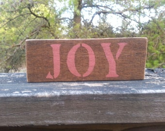 Rustic wood JOY signs.