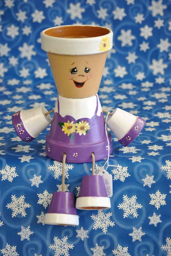 Flower pot people with a purlpe and white dress for How to make clay pot people