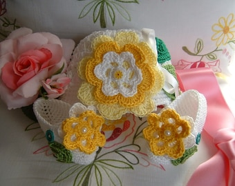 Crocheted hat and handmade shoes in white cotton with yellow flowers applied. Crochet fashion baby summer