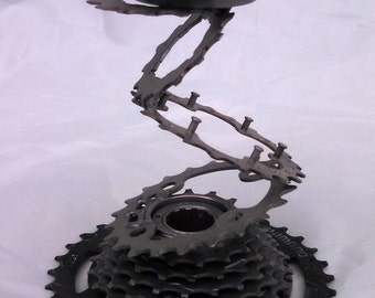 Repurposed candle holder bicycle stacked gears