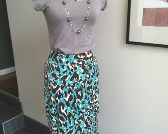 MODEST - Animal printed pencil skirt with ruffled hem