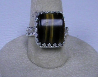 This ring is a very nice tiger eye size 8 1/2.